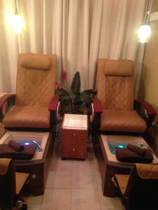 Side by side massaging pedicure stations.