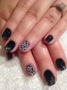 Shellac nail art design with leopard print and glitter.
